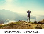 female hiker on top of the... | Shutterstock . vector #219655633