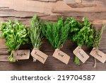 different fresh herbs on wooden ... | Shutterstock . vector #219704587