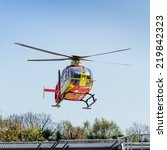 Small photo of Southampton, UK - April 8, 2014: Air ambulance helicopter takes off from Southampton Hospital