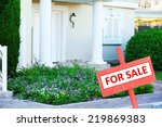 real estate sign in front of... | Shutterstock . vector #219869383
