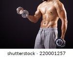 fitness man lifting dumbbells... | Shutterstock . vector #220001257