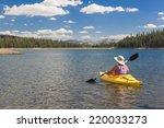 Woman Kayaking On Beautiful...