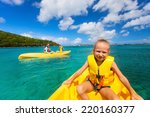 family with kids paddling on... | Shutterstock . vector #220160377