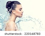 Stock photo beautiful model woman with splashes of water in her hands beautiful smiling girl under splash of 220168783
