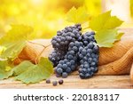 grapes on a old wooden table on ... | Shutterstock . vector #220183117