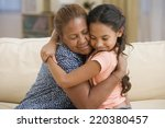 mother and daughter hugging | Shutterstock . vector #220380457