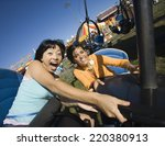 people riding a roller coaster | Shutterstock . vector #220380913