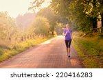 sporty woman running on a...   Shutterstock . vector #220416283
