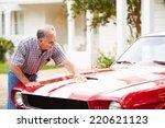 retired senior man cleaning... | Shutterstock . vector #220621123