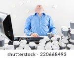 overworked businessman drinks...   Shutterstock . vector #220668493