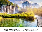 Stock photo majestic view on waterfall with turquoise water sunny beams in the plitvice lakes national park 220863127