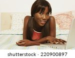 african woman typing on laptop... | Shutterstock . vector #220900897