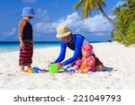 father and kids making sand... | Shutterstock . vector #221049793