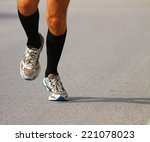 very fast runner with sneakers... | Shutterstock . vector #221078023