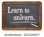 Small photo of learn to unlearn - advice or motivation words on a vintage slate blackboard
