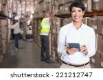 pretty warehouse manager using... | Shutterstock . vector #221212747