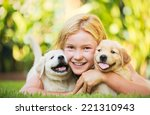 Stock photo adorable cute young girl playing and hugging puppies 221310943