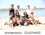 beautiful young people on beach | Shutterstock . vector #221374453