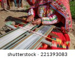 the woman weaves multi colored... | Shutterstock . vector #221393083