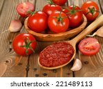 tomato paste in wooden spoon on ... | Shutterstock . vector #221489113