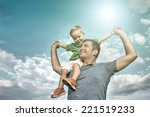 son seating on the father under ... | Shutterstock . vector #221519233