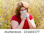 Small photo of Fat woman with allergic rhinitis in the meadow
