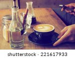 cup of coffee in coffee shop... | Shutterstock . vector #221617933