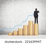 businessman drawing a monetary...   Shutterstock . vector #221639947