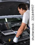 professional mechanic using a... | Shutterstock . vector #221644957