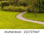 driveway in a lawn | Shutterstock . vector #221727667