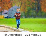 happy boy running under an... | Shutterstock . vector #221748673