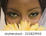 African Woman With Flower In...