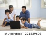asian family looking at laptop | Shutterstock . vector #221839603