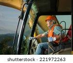 male operator driving excavator ... | Shutterstock . vector #221972263