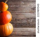 Three Pumpkins On Wooden...