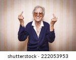 cool elder lady making middle... | Shutterstock . vector #222053953