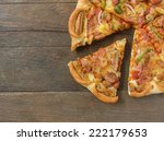 separately pizza on wood. | Shutterstock . vector #222179653