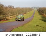 Small photo of Windsor Great Park in Winter viewed from the Long Walk with a Tractor and Trailer on the road