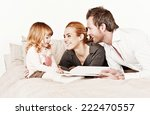 mother  father and daughter... | Shutterstock . vector #222470557