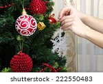 girl hanging decorative toy... | Shutterstock . vector #222550483