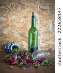 Small photo of Still life, withered roses and unpalatable wine