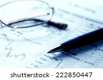 close up of eyeglasses and pen... | Shutterstock . vector #222850447