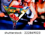Stock photo red dice in the cocktail glass in front of gambling table casino series 222869023