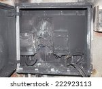 Small photo of Distribution board breaker panel of an electricity supply system damaged by surge caused by lightning