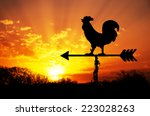 Rooster Weather Vane Against...