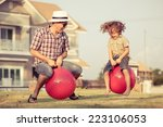 dad and son jumping on... | Shutterstock . vector #223106053