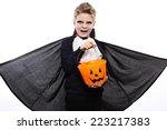 boy with pumpkin basket dressed ... | Shutterstock . vector #223217383