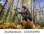 bow hunter crouching | Shutterstock . vector #223242493