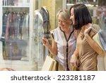 two women looking through shop... | Shutterstock . vector #223281187