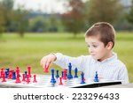 elegant young boy in white... | Shutterstock . vector #223296433